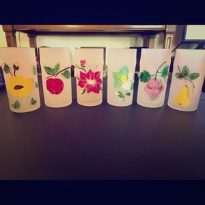 Hand painted glass cups with different fruits.